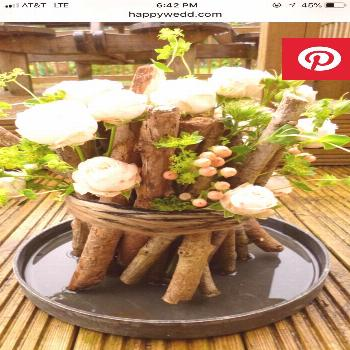 pretty rustic table centerpiece with branches, flowers, and greenery - pretty rustic table centerpi